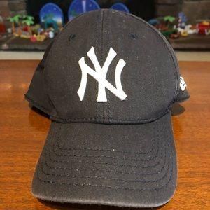 New Era New York Yankees hat.